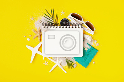 Bild Planning summer holidays, trip and vacation background. Travelers notebook with accessories on fashion yellow table top view. Flat lay.