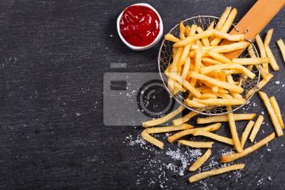 Bild Pommes frites mit Ketchup