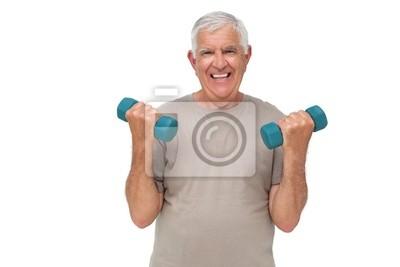 Portrait eines glücklichen Senior Mann, die Ausübung mit Hanteln