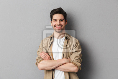 Bild Portrait of a happy young casual man standing