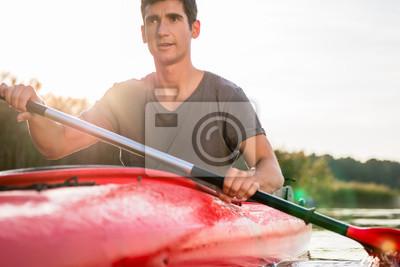 Bild Portrait of a man kayaking on lake