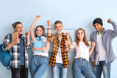 Bild Portrait of happy young students on color background