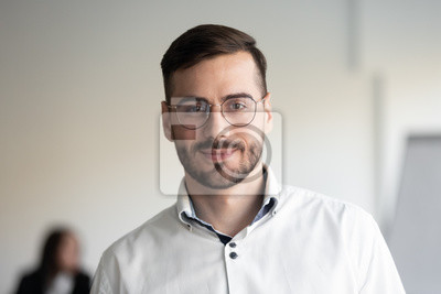 Bild Portrait of millennial businessman posing looking at camera
