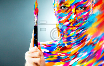 Portrait of the bright beautiful girl with art make-up and brush