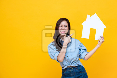 Bild Portrait of young happy excited Asian woman holding paper home