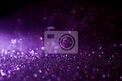 Bild Purple glitter magic background. Defocused light and free focused place for your design.