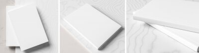 Bild Realistic hardcover book or catalogue mock up on gray - white marble background.  White hardcover book mock up  rendered with three different variations. 3D illustration.