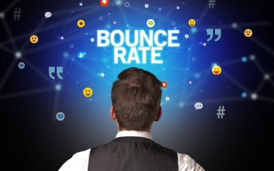 Rear view of a businessman with BOUNCE RATE inscription, social networking concept