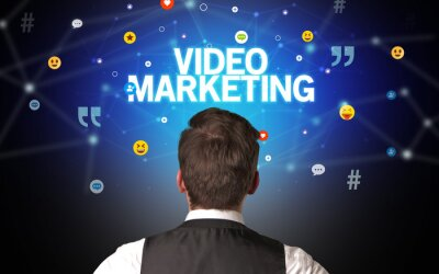 Rear view of a businessman with VIDEO MARKETING inscription, social networking concept