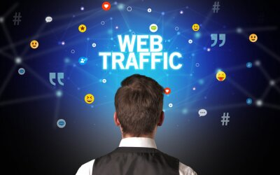 Rear view of a businessman with WEB TRAFFIC inscription, social networking concept