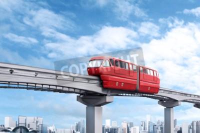 Bild Red Monorail Zug gegen blauen Himmel und moderne Stadt im Hintergrund