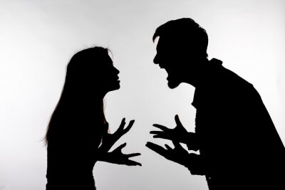Bild Relationship difficulties, conflict and abuse concept - man and woman face to face screaming shouting each other dispute silhouette isolated on white background