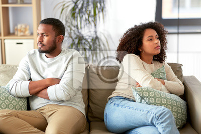 Bild relationship difficulties, conflict and people concept - unhappy african american couple having argument at home