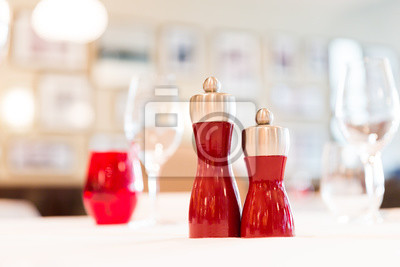 Restaurant Table Red Salt And Pepper Shakers With Blurred Background