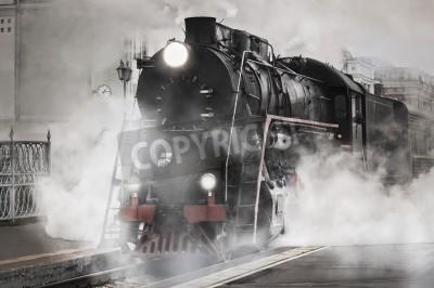 Bild Retro Dampfzug fährt vom Bahnhof