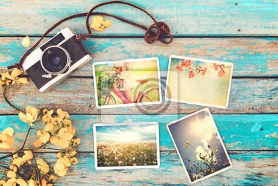 Bild Retro Kamera und Instant Papier Fotoalbum auf Holz Tisch mit Blumen Grenze Design - Foto von Erinnerung und Nostalgie im Frühjahr. Vintage-Stil
