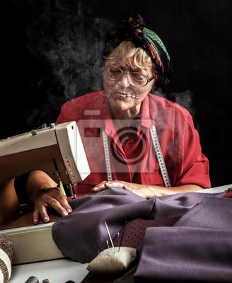 Bild Retro woman sewing and smoking cigarettes