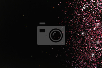 Bild Rose gold glitter on black background, top view with space for text