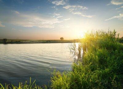 Bild Ruhiger Fluss bei Sonnenuntergang
