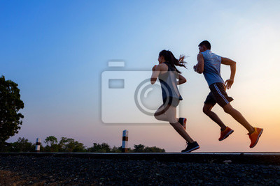 Bild Running at sunrise couple exercising for marathon and workout .fitness, sport, people and lifestyle concept - Happy couples exercising with outdoor running
