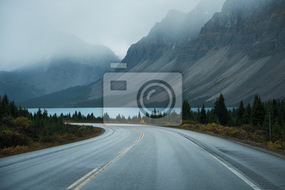 Bild Scenic road trip with rocky mountain and lake in gloomy day