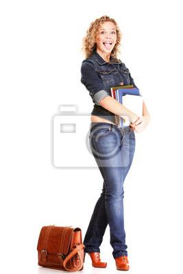 Schöne blonde junge Frau stehend in voller Körper in Jeans isolieren