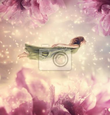 Schöne junge Frau mit riesigen Blumen