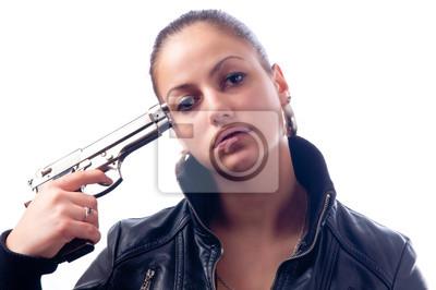 Schöne Teenager-Mädchen mit Pistole an den Kopf