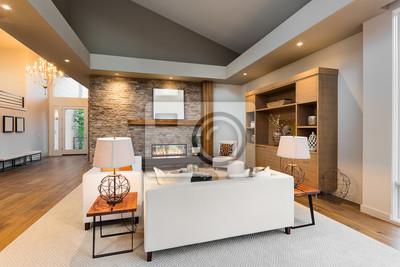 Bild: Schöne wohnzimmer interieur mit parkettboden und kamin in neuen