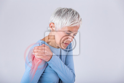 Bild Senior woman with shoulder pain. Elderly woman is enduring awful ache. Shoulder Pain In An Elderly Person. Senior lady with shoulder pain