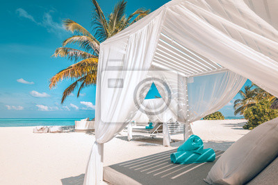 Bild Serenity beach background, luxury beach canopy and travel or summer vacation concept. Luxury beach scene. Summer vacation and holiday concept