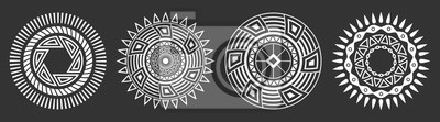 Bild Set of four abstract circular ornaments. Decorative patterns isolated on black background.