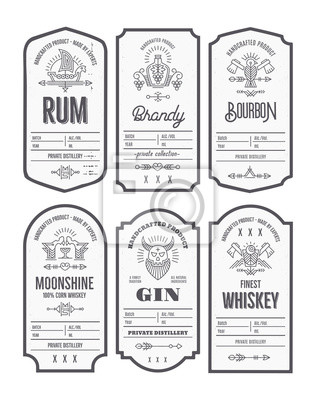 Bild Set of vintage bottle label design with ethnic elements in thin line style.