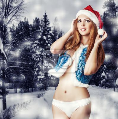 Sexy woman santa claus in white pants