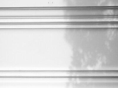 Bild shadow of leaf on white wall background