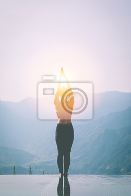 silhouette woman practice yoga Surya Namaskar exercise Ekam pose on the pool above the Mountain peak in the morning in front of beautiful nature views in SAPA vietnam,Feel comfortable