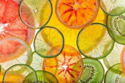 Bild Sliced fruits background