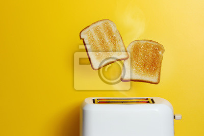 Bild Slices of toast jumping out of the toaster