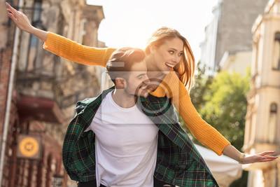 Bild Smiling beautiful couple dating outdoors.