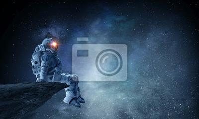 Bild Spaceman on rock edge. Mixed media