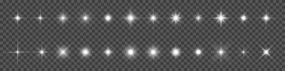 Bild Sparkling star, vector glowing star light effect. Glitter magic star sparks on transparent background.