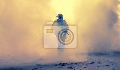 Bild Special operations forces soldier, army ranger or commando in camo uniform, helmet and ballistic glasses walking at battlefield covered with smoke. Airsoft war game player coming through smoke screen