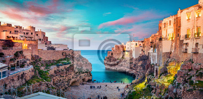 Bild Spectacular spring cityscape of Polignano a Mare town, Puglia region, Italy, Europe. Colorful evening seascape of Adriatic sea. Traveling concept background..