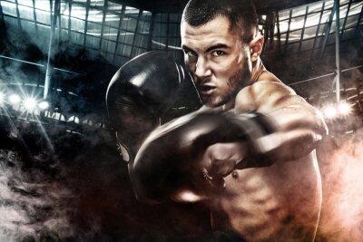 Bild Sportler muay Thai Boxer kämpfen in Boxkäfig. Hintergrund mit Lichtern und Rauch. Text kopieren Sport-Konzept.