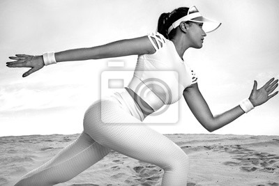 Sporty young woman and fit athlete runner running on the sky background. The concept of a healthy lifestyle and sport. Woman in white sportswear.