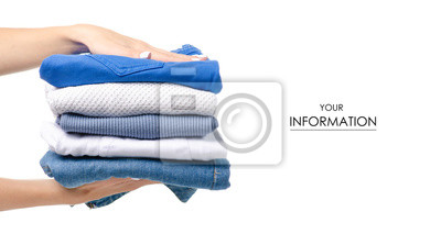 Bild Stack of clothing jeans sweaters in hand pattern on a white background isolation