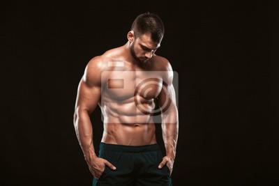 Bild Starke Athletic Man - Fitness-Modell zeigt seine perfekte Rückseite auf schwarzem Hintergrund mit copyspace isoliert
