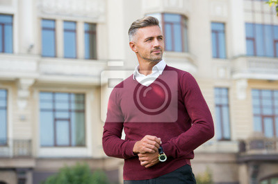 Bild Status and reputation. Man mature well groomed handsome model with wrist watch. Expensive luxury accessory. Watch repair. Gift shop. Confident macho with luxurious watch urban background defocused