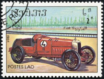 Bild Stempel gedruckt in Laos, die eine Vintage Fiat S57-Sportwagen