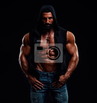 Bild Strong Mysterious Muscular Men Wearing Hooded Jacket Exposing his Muscular Torso